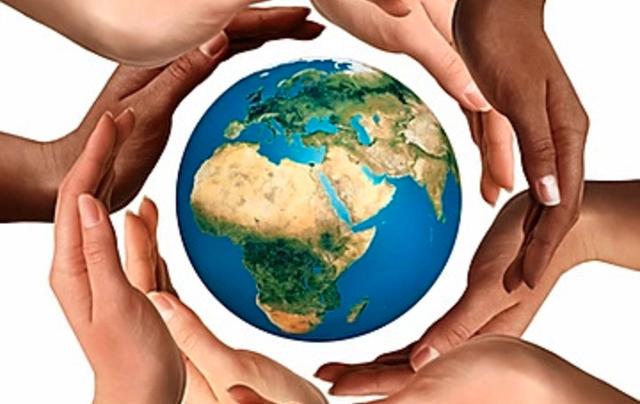 Hand around earth image